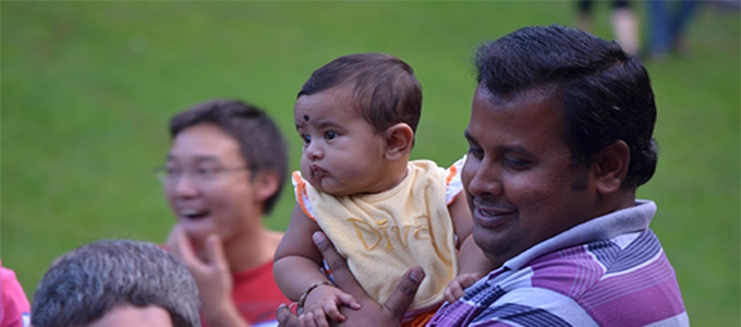 Man with child at outdoor event
